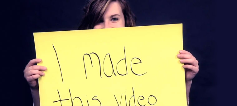"Photo of Student Holding Sign; ""I Made This Video"""