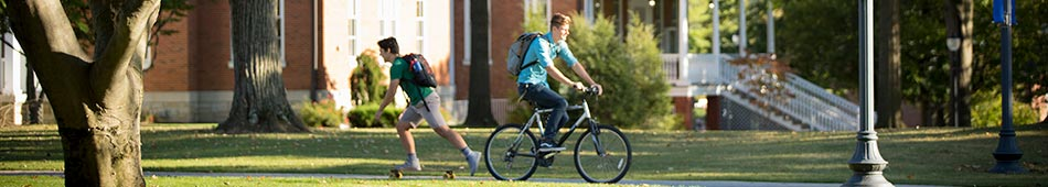 Students on Bike and Skateboard Photo