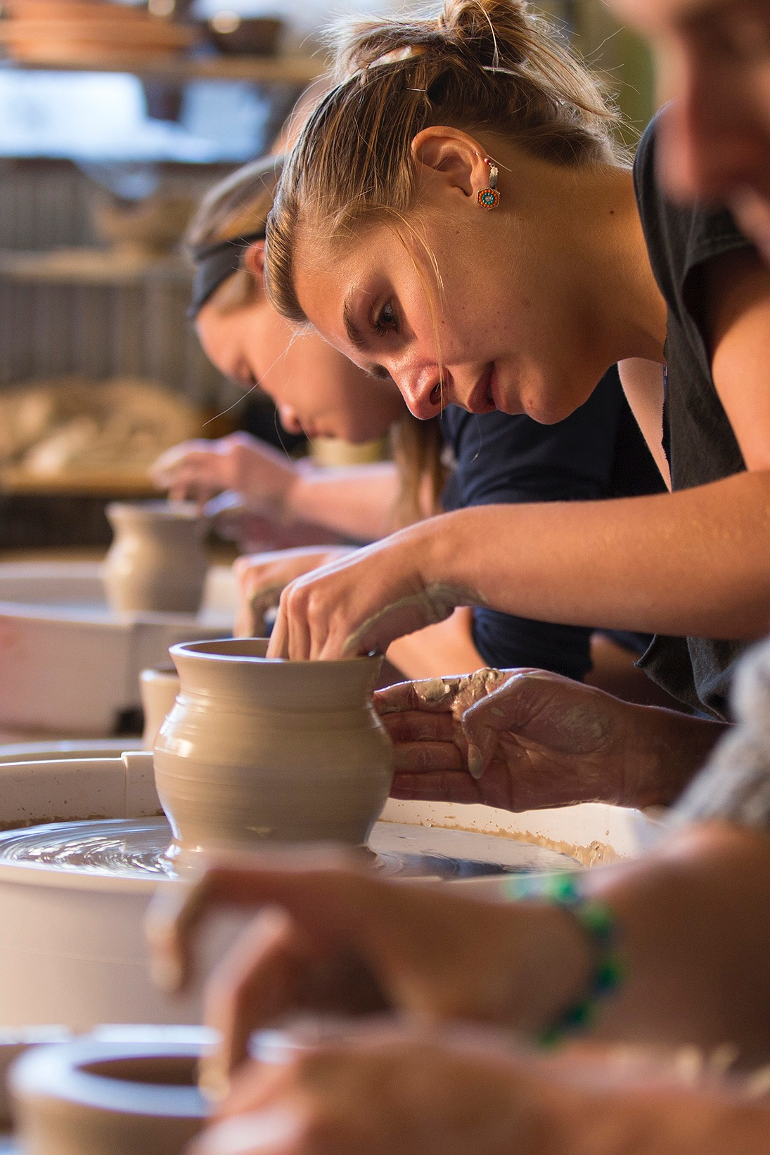 A student throws a bowl for the Empty Bowls event